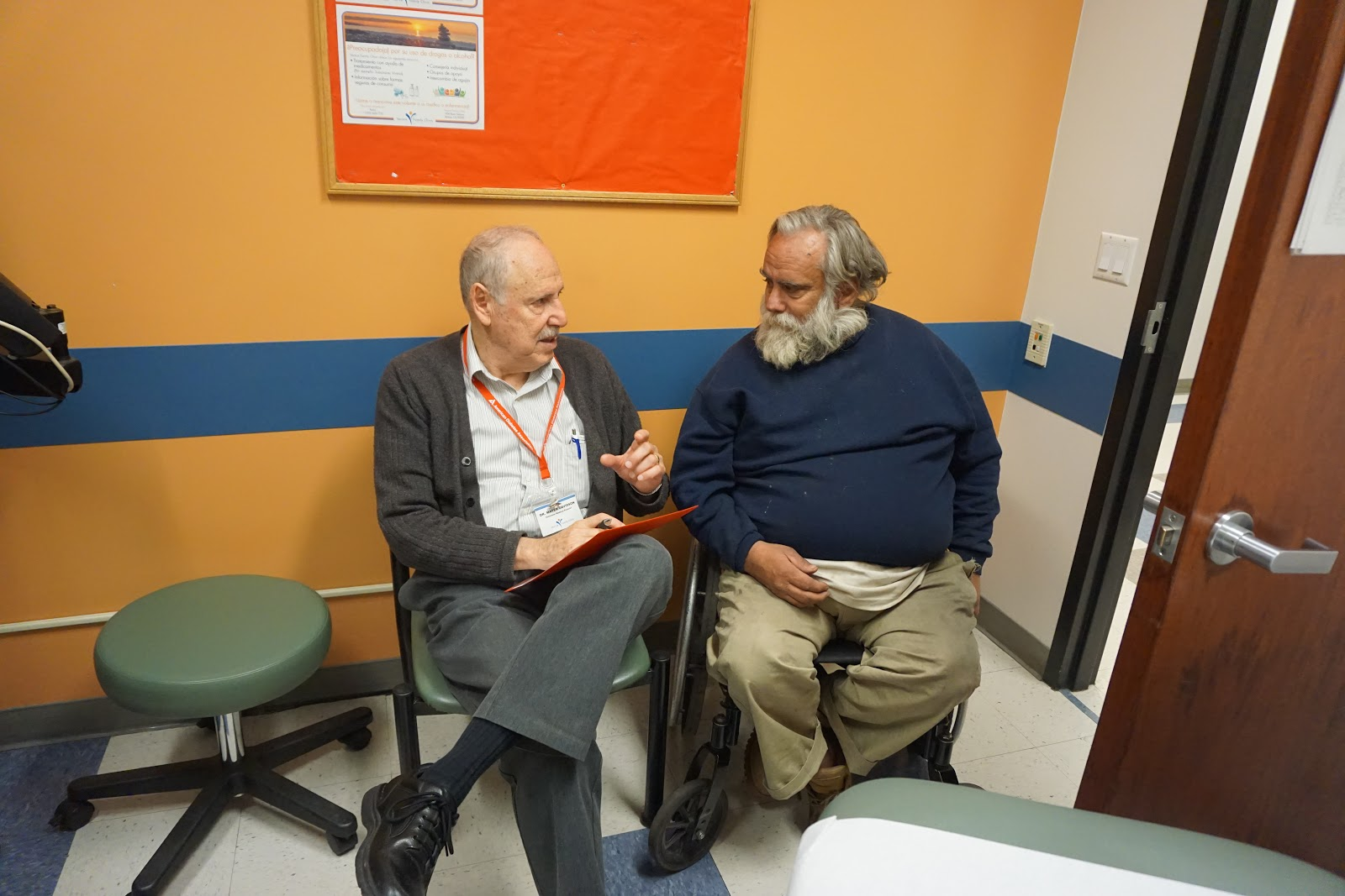 Figure 4. Dr. Mayer Davidson, co-founder of Venice Family Clinic, meets with an unsheltered patient in the office to provide specialty care. Taken by Pam Kerr of Venice Family Clinic.