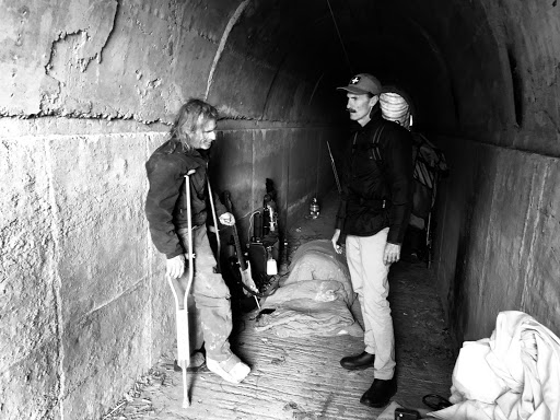 Figure 2. Dr. King visits a patient who has taken shelter in a tunnel. Taken by Alex Gittinger of The People Concern.