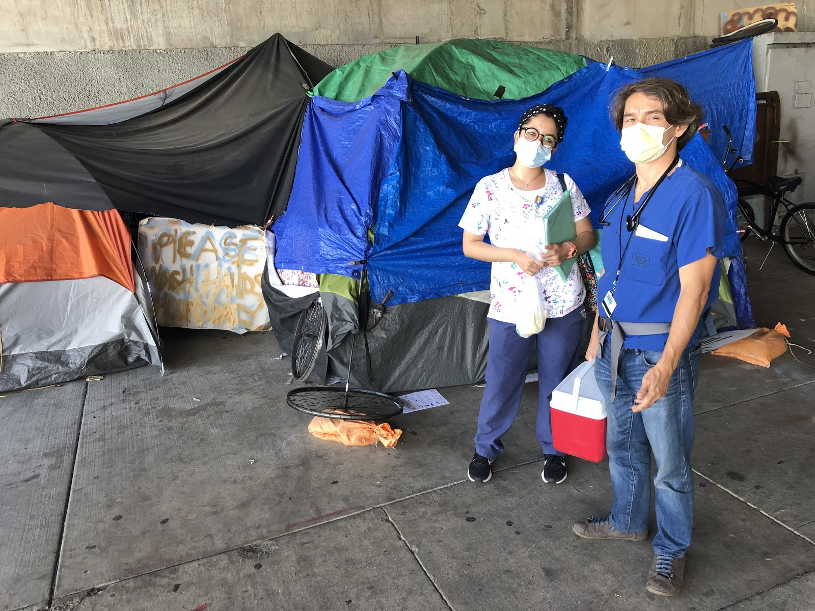 Figure 14.  Dr. Gilmore Chung and Medical Assistant III, Letty, go to the people under the bridge with vaccinations. Taken by Dr. Coley King of Venice Family Clinic.
