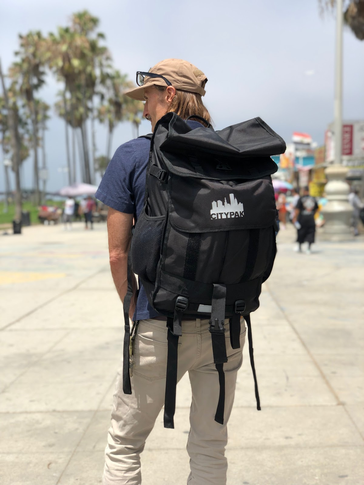 Dr. King with a Citypak on the Venice Beach Boardwalk. Citypak, a nonprofit, has donated countless backpacks for the unsheltered people on and near Venice Beach. Venice Family Clinic Photos.