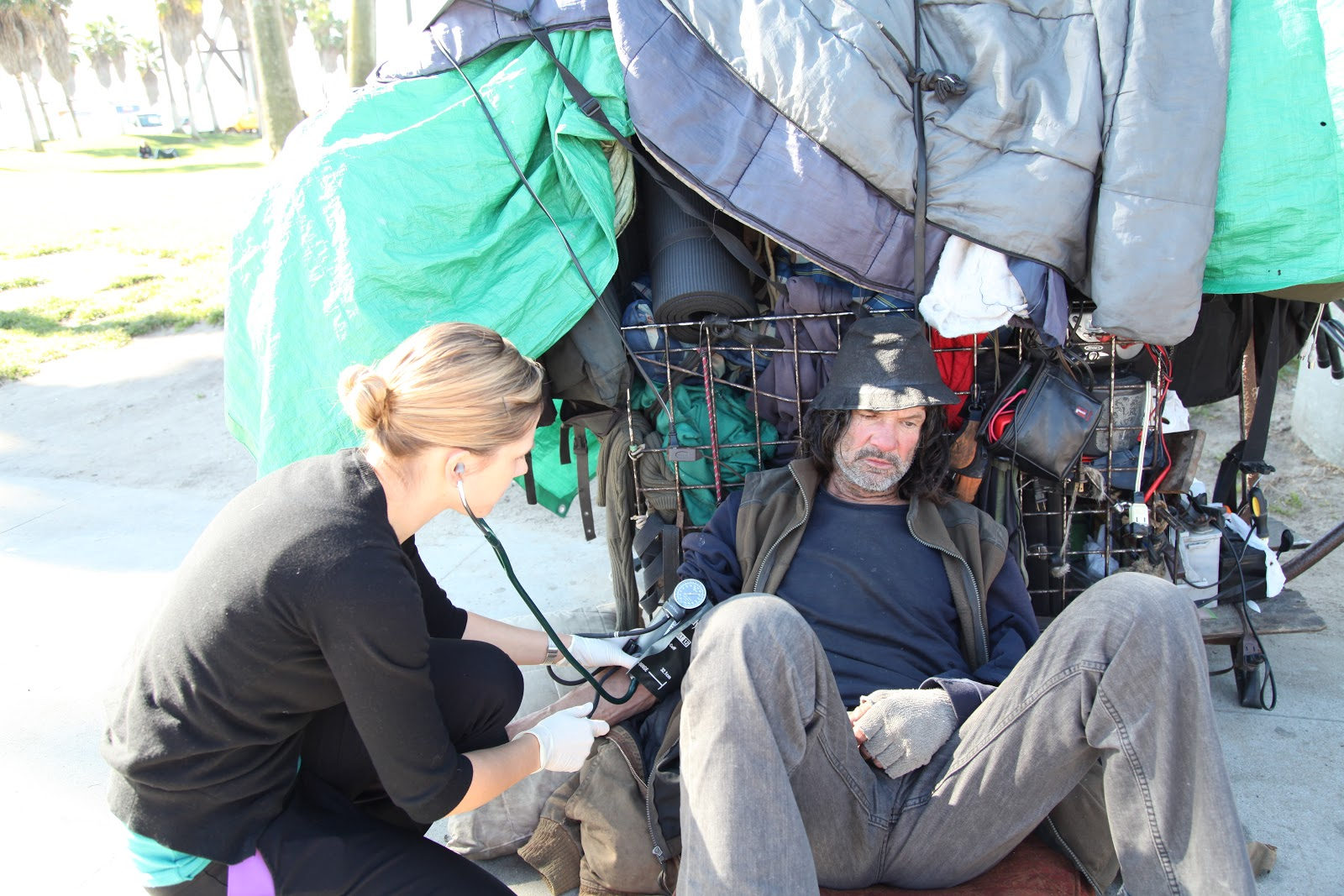 Checking vital signs in the field. Taken by Margaret Molloy.