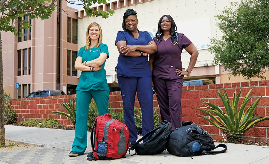 Carrie Kowalski, PA-C, Lachune Price, PA-C, and Ebony Funches DNP, of Venice Family Clinic show off their street medicine attire and backpacks. Cedars Sinai Photos.